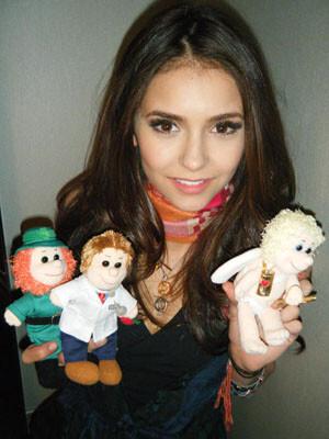 Нина Добрев с куклами от Karma